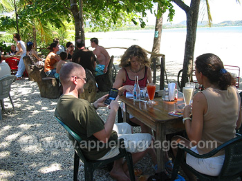 Students having lunch on the beach