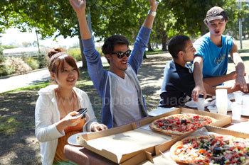 Eating pizza in the park